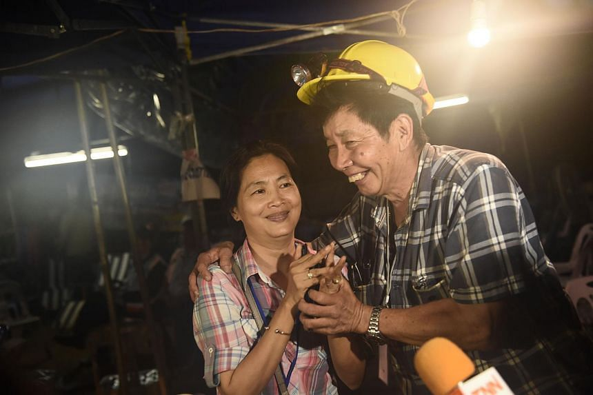 Family members celebrating upon receiving news on that their children were found alive in the depths of the 10-kilometre long cave.