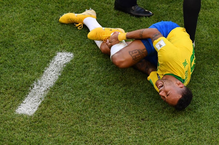Clockwise, from above: Brazil forward Neymar after being tackled by Switzerland's Valon Behrami; sent tumbling by Costa Rica's Johnny Acosta; clutching his jaw after being fouled by Serbia's Dusan Tadic; after being stepped on by Mexico's Miguel Layu