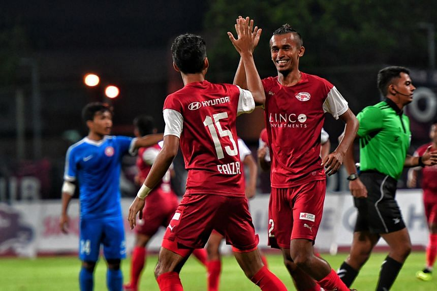 Home United's Shakir Hamzah celebrating with Faizal Roslan after he scored the first goal in their 4-1 win over the Young Lions in the Singapore Premier League on June 6. The Protectors' erratic form so far and Albirex's perfect record mean their tit