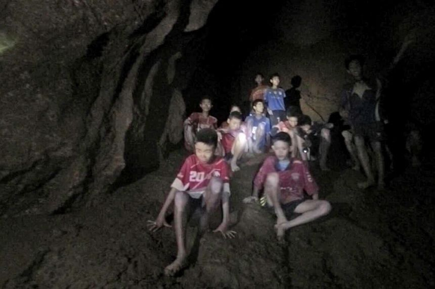 Above: The 12 young members of a football team and their 25-year-old coach were found on Monday inside the deep area of Tham Luang cave, about 4km from its entrance, after they went missing on June 23. Left: Family members of the missing children cam