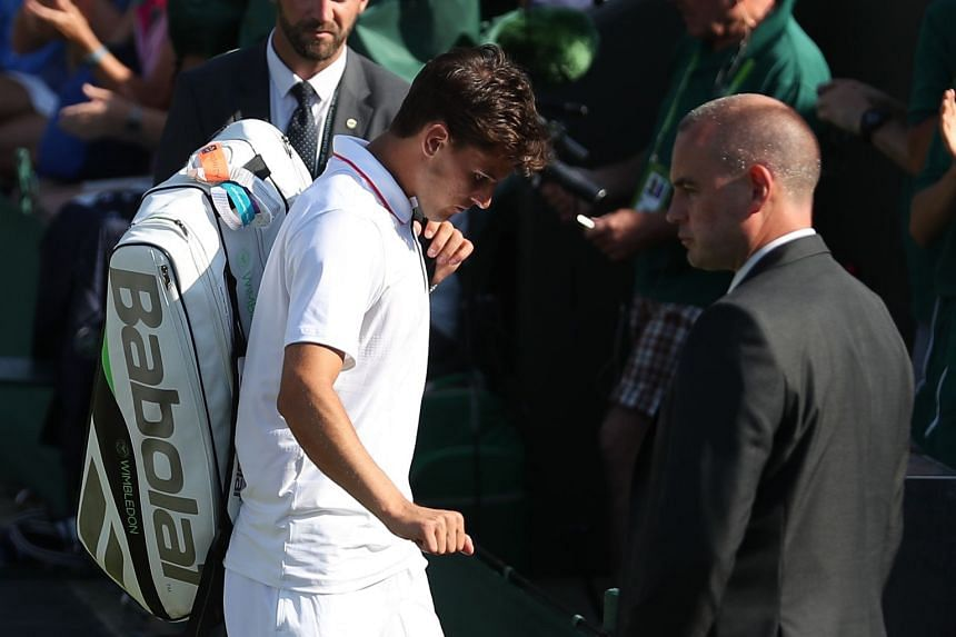 Thiem leaves court 2 after retiring against Cyprus' Marcos Baghdatis.