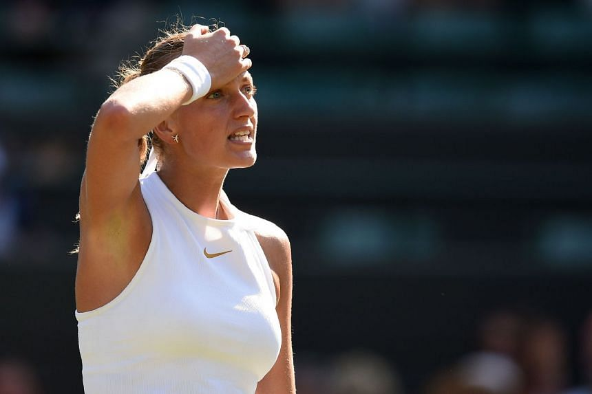 Kvitova reacts against Belarus' Aliaksandra Sasnovich during their women's singles first-round match.