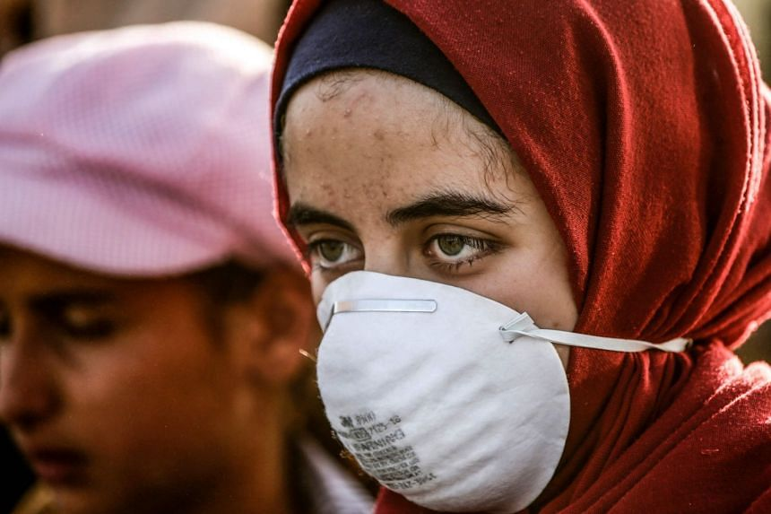A woman looks on during a demonstration by Palestinian women along the border with Israel east of Gaza City.