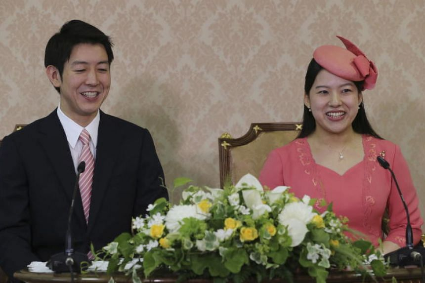 Japanese Princess Ayako, the third daughter of the late Prince Takamado and her fiance Kei Moriya attend a press conference to announce their engagement at Imperial Household Agency in Tokyo, on July 2, 2018.