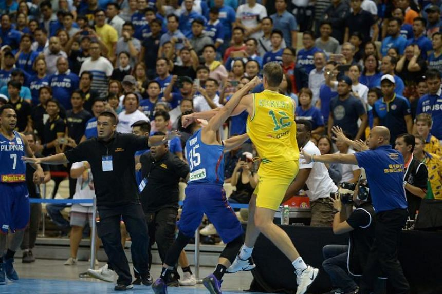 Mathew Wright (left) of the Philipines engages Daniel Kickert of Australia in a brawl during their FIBA World Cup Asian qualifier game at the Philippine arena in Bocaue town, Bulacan province, north of Manila on July 2, 2018.
