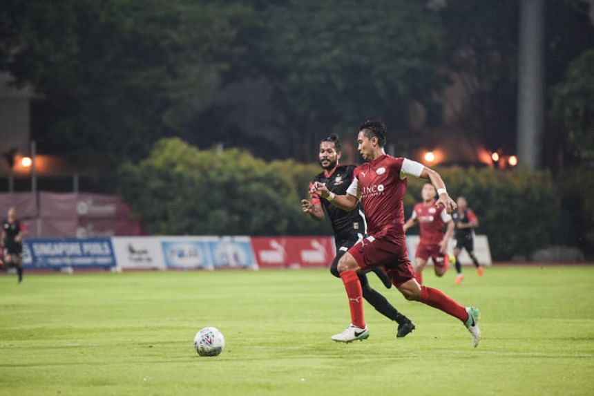 Home United's Shahril Ishak dribbling the ball towards the goal in a match between Home United and Brunei DPMM on May 26, 2018.