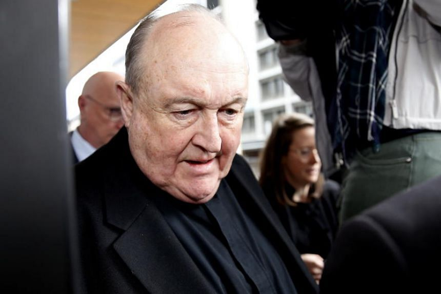 Archbishop Philip Wilson leaves after sentencing at Newcastle Local Court in Newcastle, Australia, on July 3, 2018.