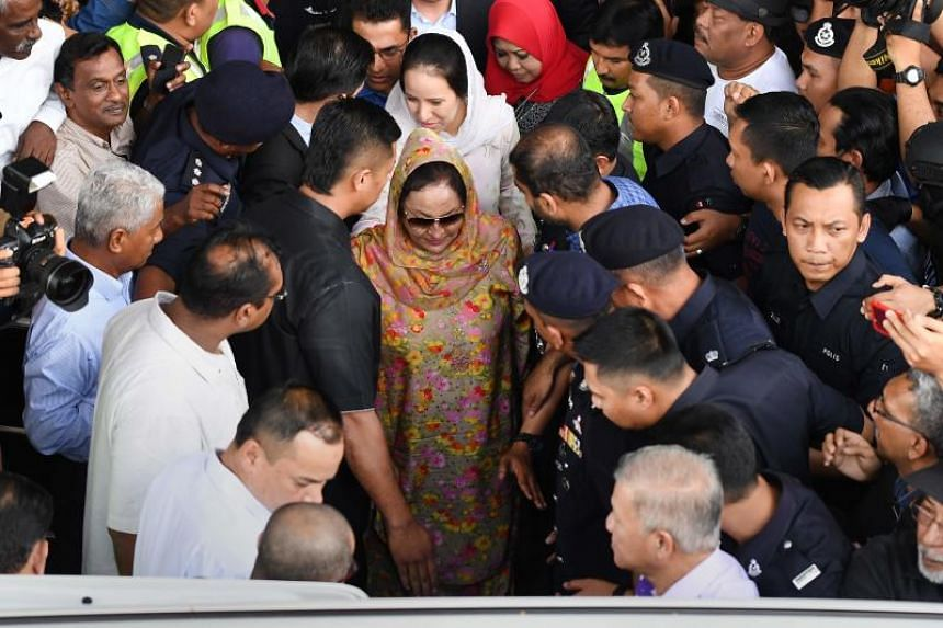 Rosmah Mansor (centre), wife of former Malaysian prime minister Najib Razak, leaves the Duta court complex after her husband posted bail in Kuala Lumpur, on July 4, 2018.