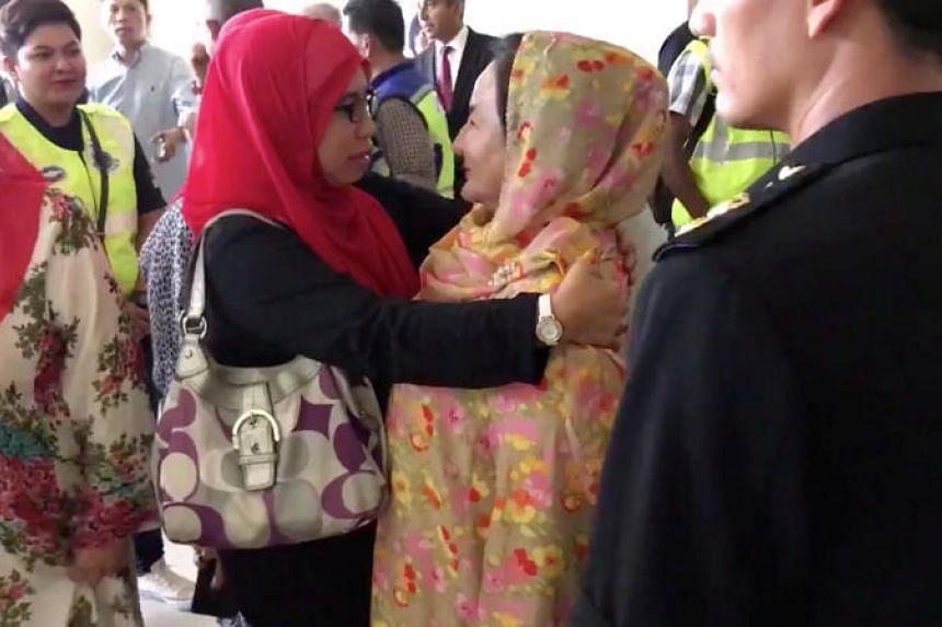Rosmah Mansor, wife of former Malaysian prime minister Najib Razak, greets relatives in Kuala Lumpur, Malaysia, in this still image taken from social media video July 4, 2018.