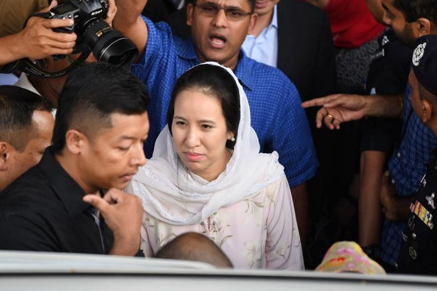 Nooryana Najwa Najib (centre), daughter of former Malaysian prime minister Najib Razak, leaves the Duta court complex after her father posted bail in Kuala Lumpur, on July 4, 2018.