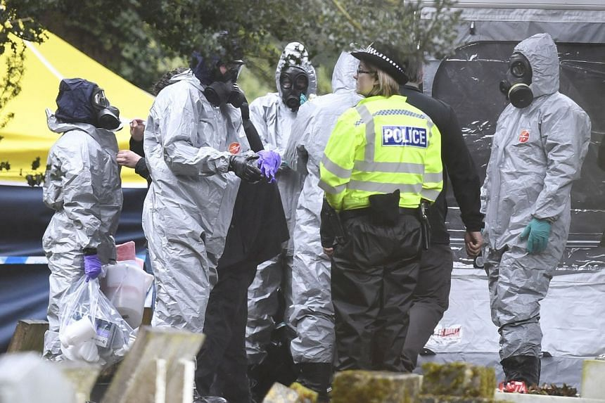 Forensic police officers work at a grave site in Salisbury Crematorium in Salisbury, southern England, in March 2018.