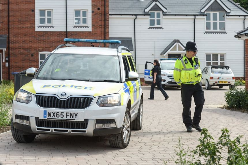 Police at a home in Muggleton Road, Amesbury, where emergency services found a man and woman unconscious.