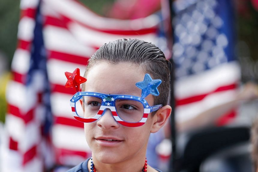 A boy celebrates the US Independence Day holiday in Avondale Estates, Georgia.