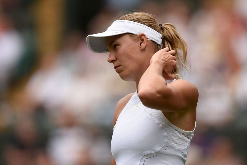 Wozniacki reacts during the second round match against Russia's Ekaterina Makarova.