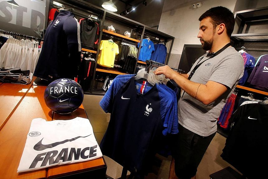 France team soccer jerseys on display at a Nike sporting goods store in Marseille, France. Nike supplied shirts for 10 countries in this year's World Cup, while rival adidas kitted out 12 teams.