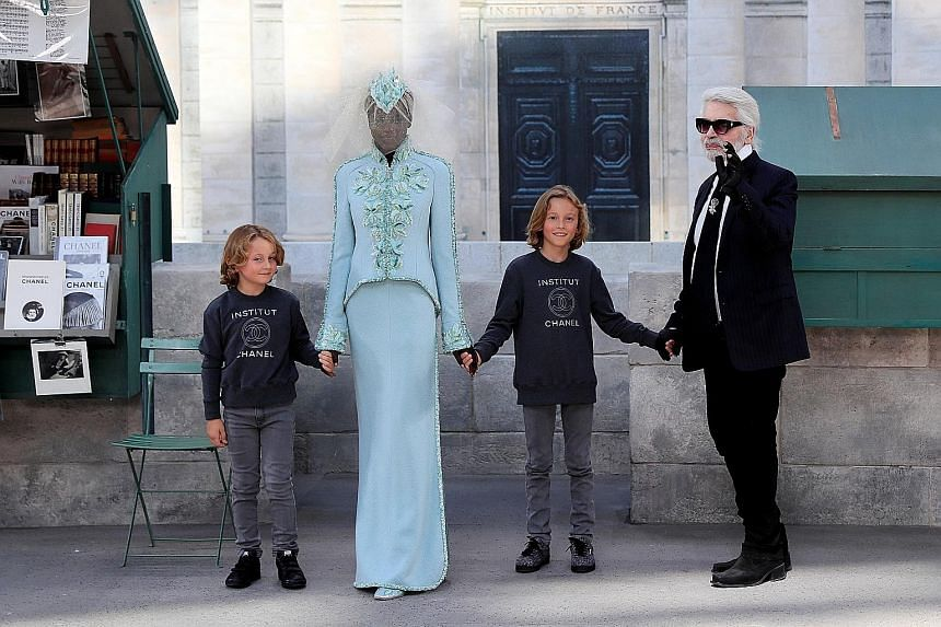 Designer Karl Lagerfeld (right) at his haute couture autumn/winter show for Chanel at the Grand Palais. With him are his godsons Jameson (left) and Hudson Kroenig and South Sudanese-Australian model Adut Akech.