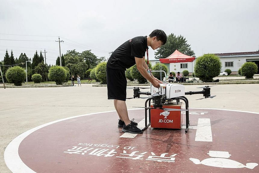 """A JD.com drone at the company's testing site in Xi'an, China. JD.com is racing companies from across the world to develop unmanned aerial vehicles with the strength, range and reliability to deliver goods on a large scale and solve the expensive """"las"""