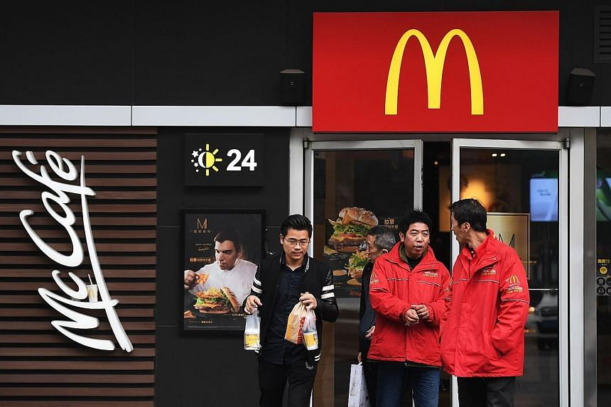 A visitor to the Disneyland in Shanghai. The China operations of McDonald's are controlled by state-backed conglomerate Citic and private equity firm Citic Capital Holdings, so a boycott risks collateral damage.