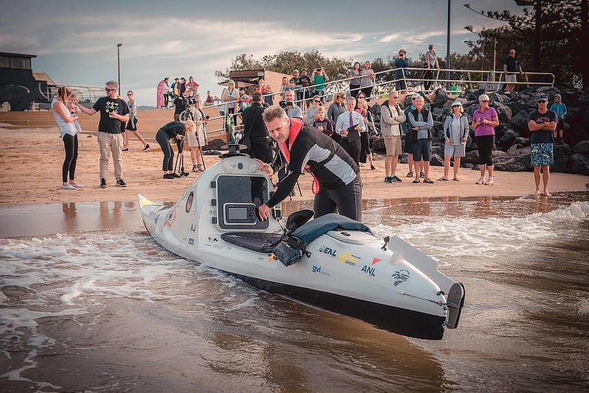 Above and left: Adventurer Scott Donaldson had set off from Australia's Coffs Harbour on May 2 on a 2,200km journey in a 6m-long kayak. He arrived at New Plymouth, on New Zealand's North Island, late on Monday night.