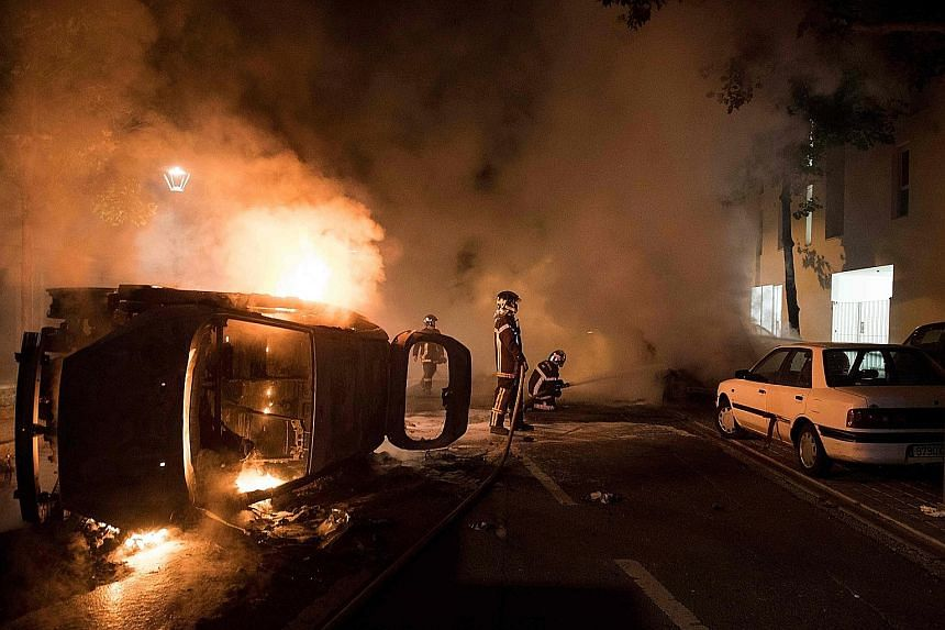 The French government called for calm yesterday after the killing of a 22-year-old man by police sparked riots in the western city of Nantes, highlighting tensions between youths and security forces in deprived urban areas. Rioters set fire to cars a