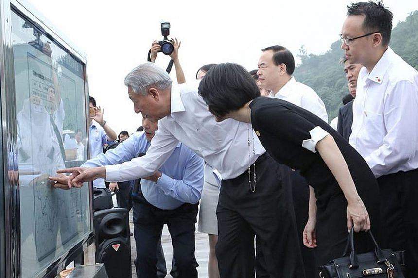 Deputy Prime Minister Teo Chee Hean visiting Guoyuan Port in south-western Chongqing yesterday.