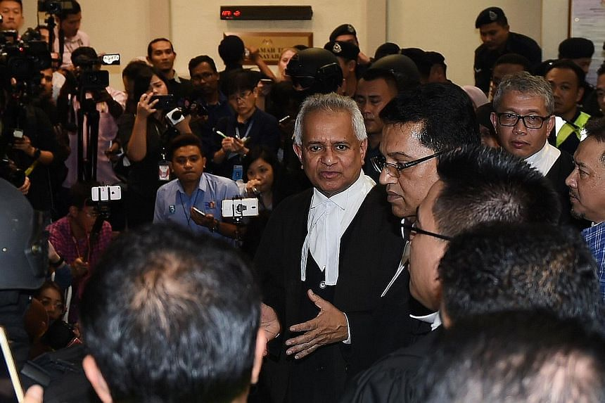 Former Malaysian prime minister Najib Razak being greeted by his supporters as he left the court in Kuala Lumpur yesterday. Najib pleaded not guilty to four charges levelled against him in relation to funds linked to SRC International, a former subsi