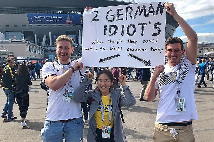 HOT SHOT Two Germany fans deciding to swallow their pride and stay on in Russia to catch Sweden's round-of-16 win over Switzerland. The deposed champions, had they qualified first in their group as many predicted, would have been the team facing the