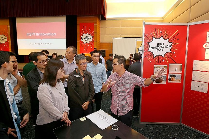 Straits Times reporter Aw Cheng Wei presenting his team's idea to colleagues during SPH's inaugural Innovation Day yesterday. Three teams presented their ideas to an executive panel made up of five members of senior management for the opportunity to