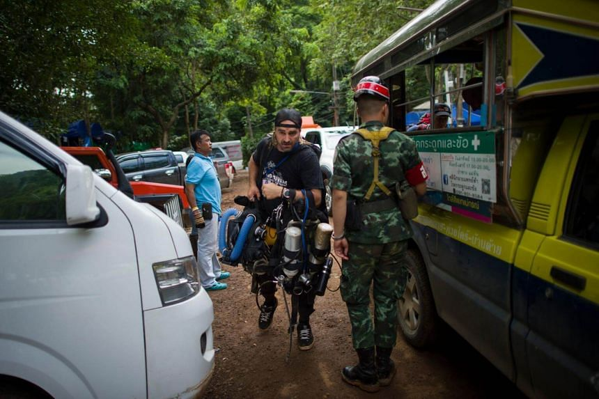 A specialist foreign diver arrives as rescue operations continue for 12 boys and their coach trapped at Tham Luang cave at Khun Nam Nang Non Forest Park in the Mae Sai district of Chiang Rai province, on July 5, 2018.