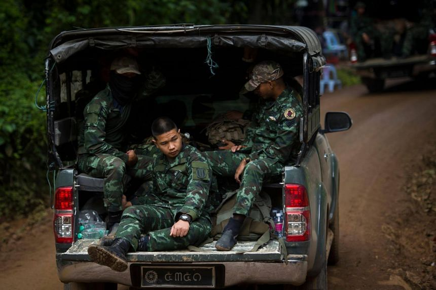 Thai soldiers arrive as rescue operations continue for 12 boys and their coach trapped at Tham Luang cave at Khun Nam Nang Non Forest Park in the Mae Sai district of Chiang Rai province, on July 5, 2018.