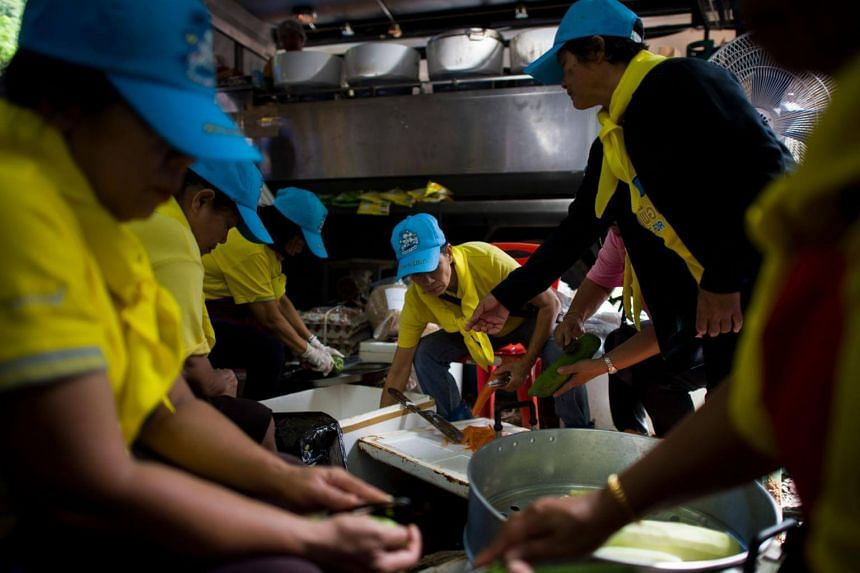 Thai volunteers cook as rescue operations continue for 12 boys and their coach trapped at Tham Luang cave at Khun Nam Nang Non Forest Park in the Mae Sai district of Chiang Rai province, on July 5, 2018.