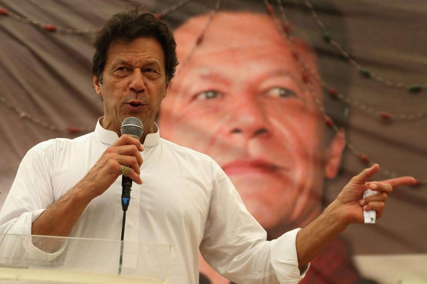 Imran Khan, head of political party Pakistan Pakistan Tehreek-e-Insaf, speaks to supporters as the country gears up for general elections, in Karachi, Pakistan, on July 4, 2018.