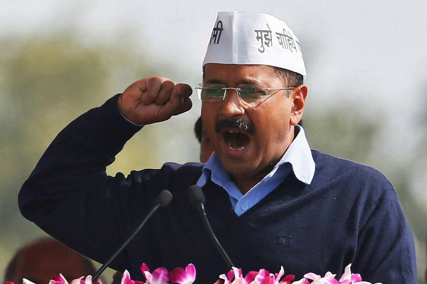 Arvind Kejriwal, chief of the Aam Aadmi Party, addresses his supporters at an event in New Delhi, on Feb 14, 2015.