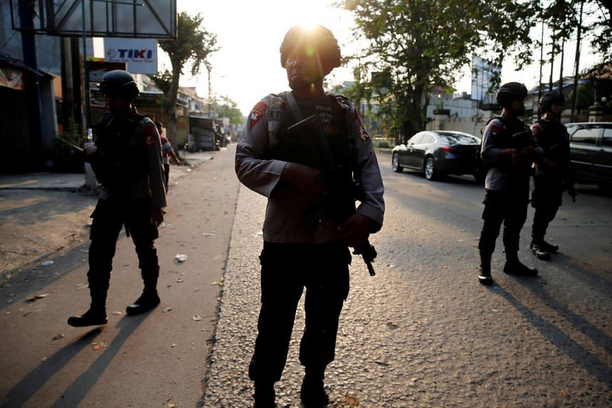 A group of mobile brigade policemen patrolling near the Mobile Police Brigade headquarters in Depok, south of Jakarta, Indonesia, on May 9, 2018.