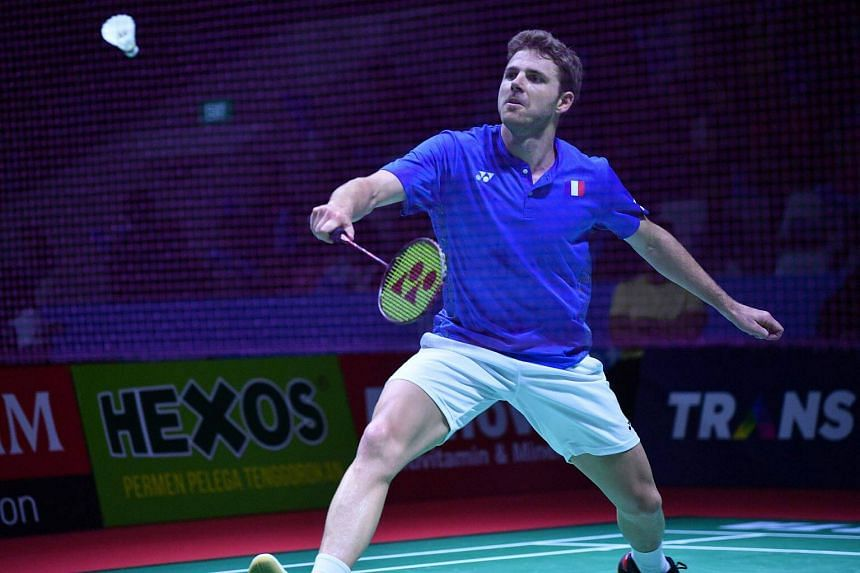 Brice Leverdez hits a return against during his men's singles badminton match at the Indonesia Open in Jakarta, on July 3, 2018.