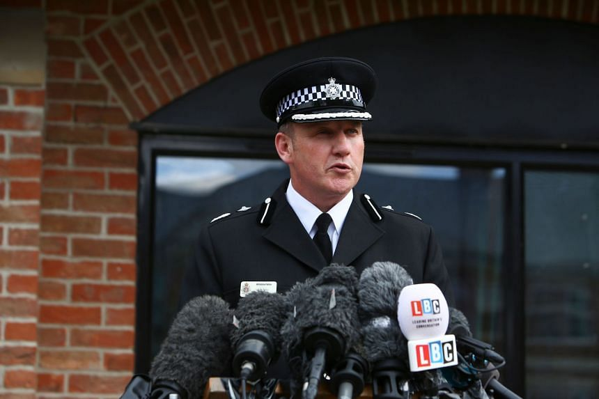 Deputy Chief Constable Paul Mills gives a statement to the media in Amesbury, southern England.