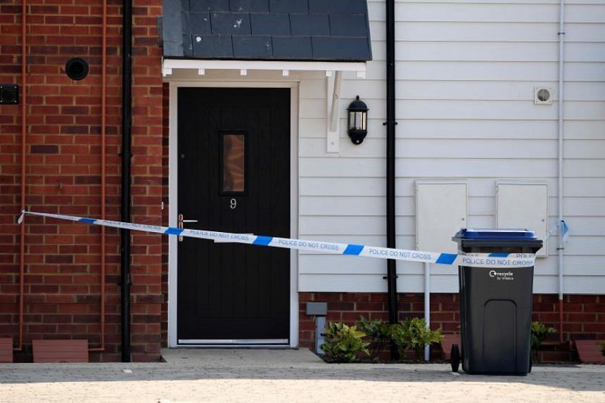 Police tape is seen cordoning off the front door on July 5, 2018, of a residential address in Amesbury, England, where police reported a man and woman were found unconscious in circumstances that sparked a major incident after contact with what was l