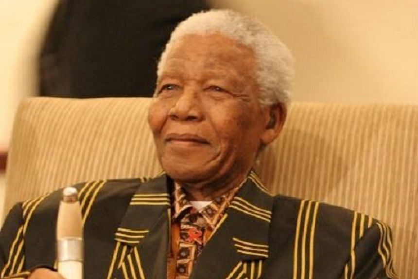A cramped 2.4m by 2.1m prison cell was Mandela's (above) home for 18 years.