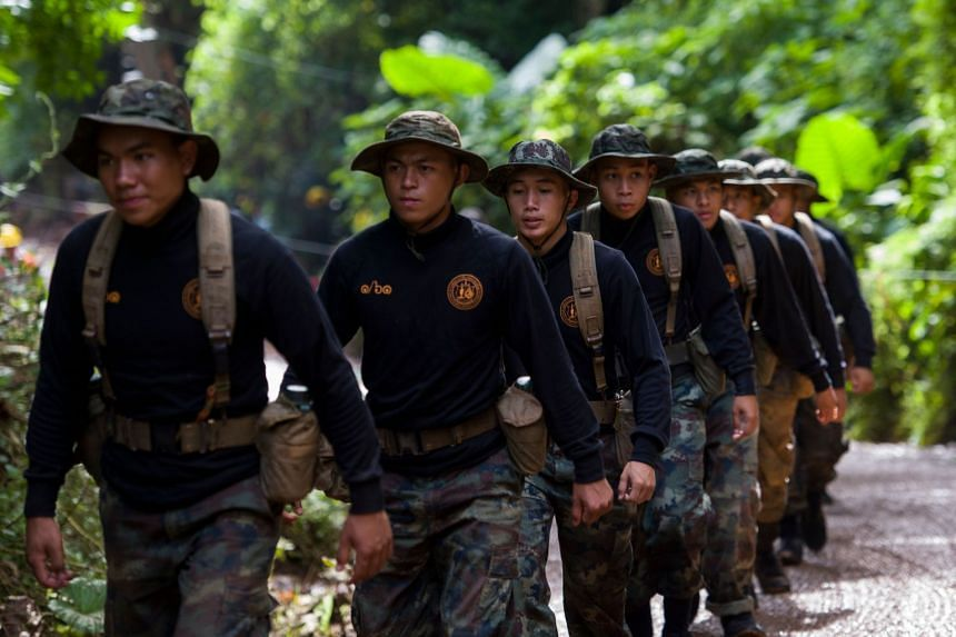 Rescue workers arrive as operations continue for 12 boys and their coach trapped at the Tham Luang cave at the Khun Nam Nang Non Forest Park in the Mae Sai district of Chiang Rai province, on July 4, 2018.