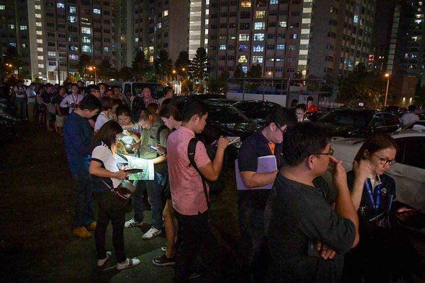 Visitors queueing at the showflat of Riverfront Residences, a new condominium development in Hougang, on July 5, 2018.