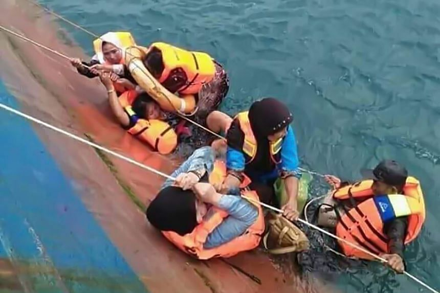 Passengers awaiting help as they cling to the stricken ferry. The KM Lestari was believed to have been carrying close to 190 people when damage to its hull forced the captain to ground the vessel.