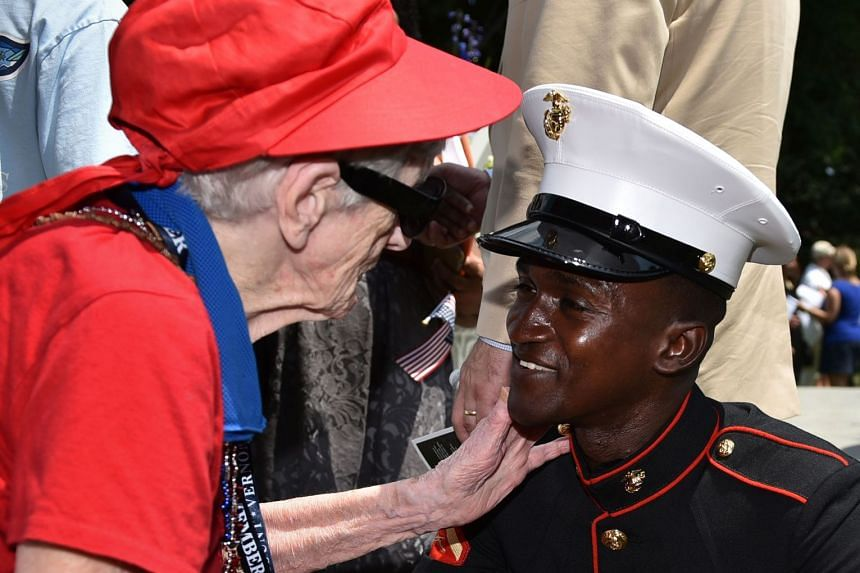 One hundred-year-old Elizabeth Zangel congratulates Marine Diallo Daouda after he became a US citizen following a naturalisation ceremony at George Washington's Mount Vernon estate during Independence Day celebrations.