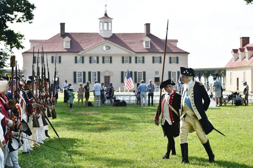 Historical re-enactor Dean Malissa, as George Washington, inspects the troops at Independence Day celebrations in Mount Vernon, Virginia.