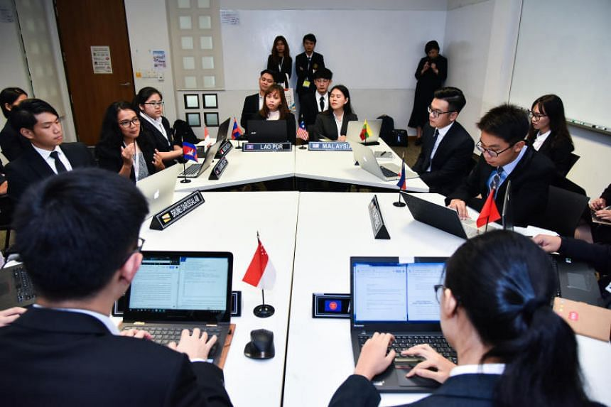 Delegates from different Asean countries simulating a sectoral meeting.