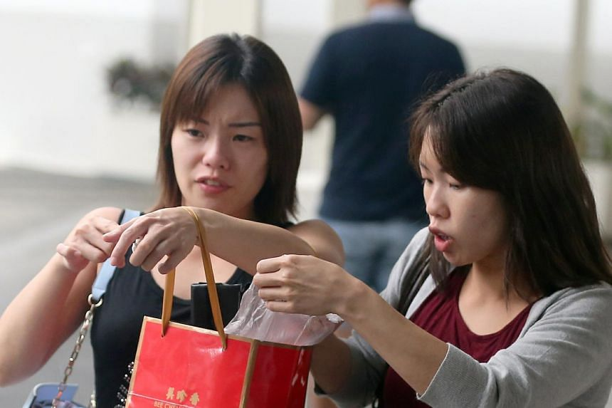 Tiffany (left) and Tiziana Kang, 30, joined the celebrations at the Shin Yeh restaurant at Liang Court on Nov 19, 2017, even though they had not been invited and did not know anyone there.