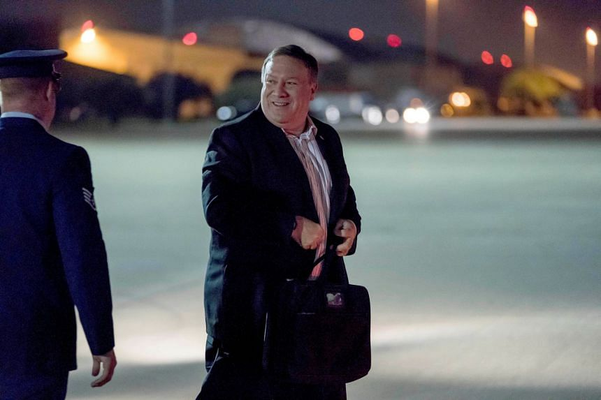 Pompeo arrives to board his plane to travel to Anchorage, Alaska, on his way to Pyongyang.
