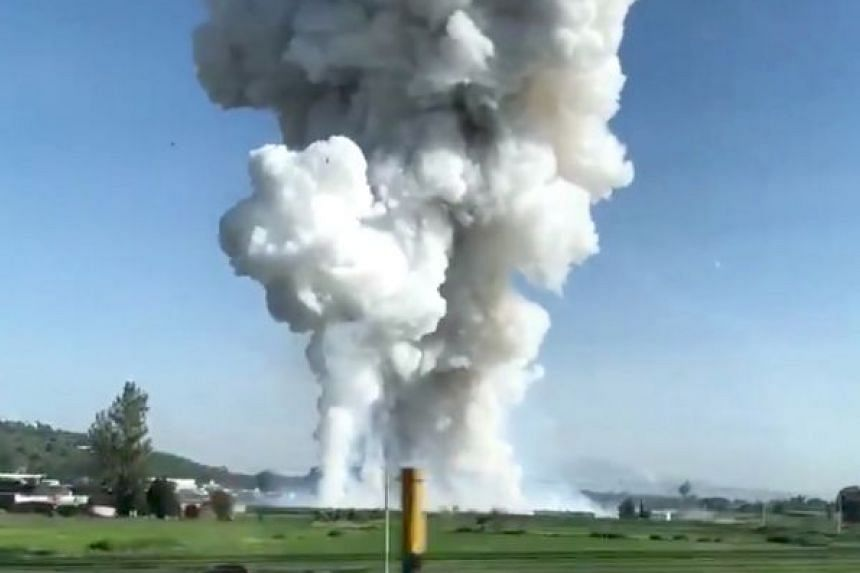 Smoke rises after a fireworks blast in Tultepec, outside Mexico City, in this image grab from social media video.