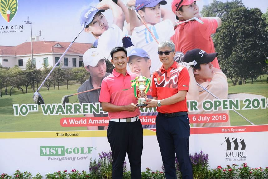 Men's Champion Jonathan Wijono of Indonesia celebrating with the 10th Warren Amateur Open trophy on July 6, 2018.
