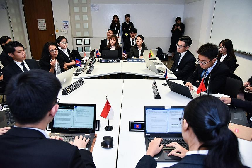 NUS political science student Jolene Yeo identifies online falsehoods as one of the most pressing challenges as Asean creates a digital economy. Student delegates from the 10 member countries simulating a sectoral meeting yesterday at the fourth Asea