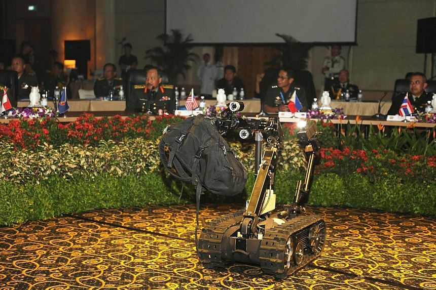 A Talon Unmanned Ground Vehicle removing a suspicious bag during a demonstration by the SAF's CBRE Defence Group at the workshop.